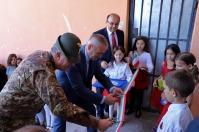 inaugurazione di una scuola parzialmente ristrutturata con fondi CIMIC italiani